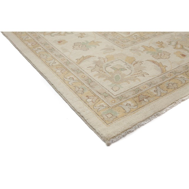 A hand knotted area rug inspired by Turkish Oushak rugs. The Turkish city of Oushak was a major rug production center...