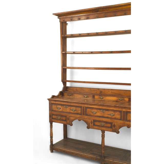 English country, 18th century sideboard with an open shelf super structure with hooks above three narrow drawers and a...