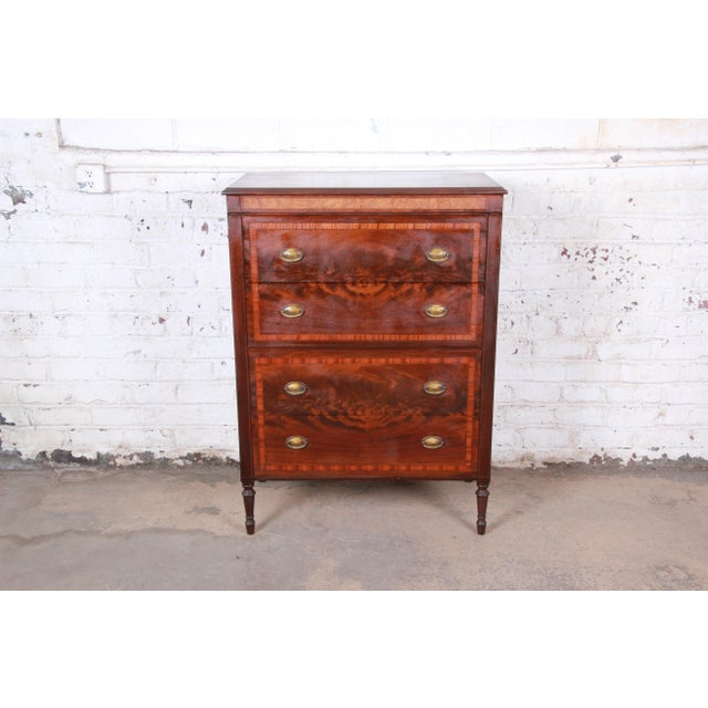 A beautiful and rare early John Widdicomb highboy dresser, circa 1920s. The dresser features gorgeous flame mahogany wood...