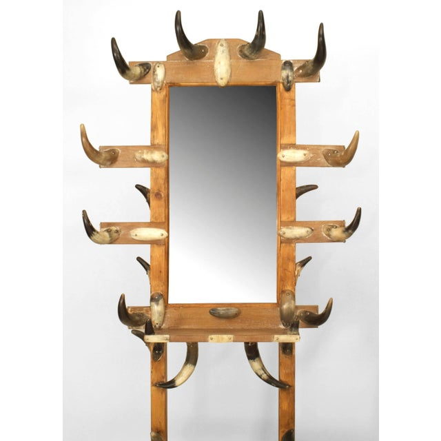 American Victorian steer horn and stripped pine hatrack/umbrella stand with a shelf and mirror.