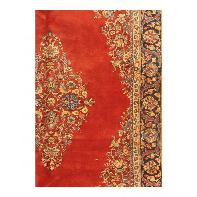 Antique Persian Sarouk rug with Art style features an impressive all-over floral design rendered in a rich color palette,...