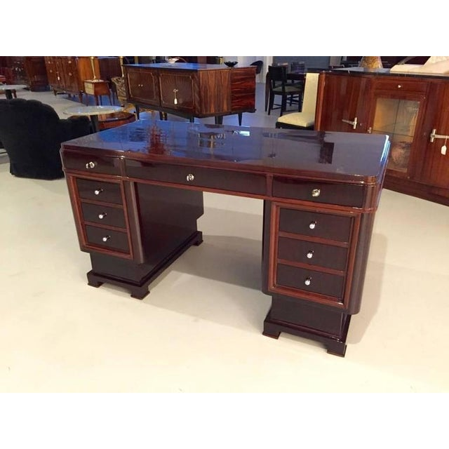 Gorgeous French Art Deco two-tone desk table. Having beautiful Deco lines and silver hardware. All the locks work making...