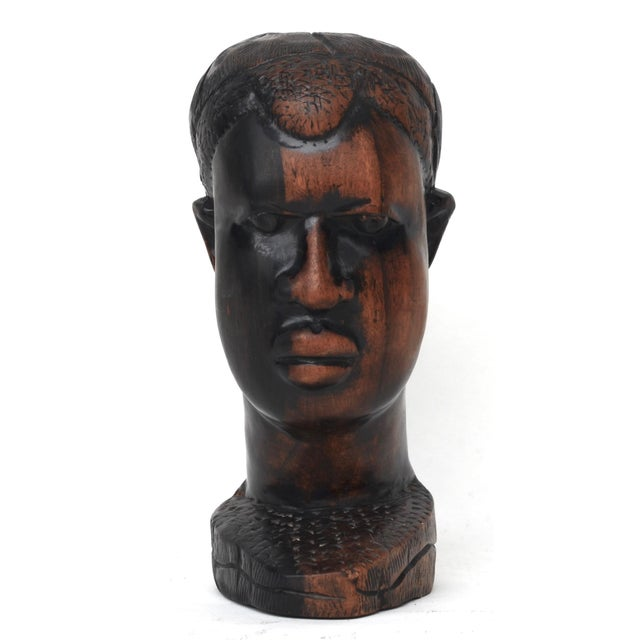 A powerful portrait head of a man, an exceptionally well-carved bust of exotic hardwood.