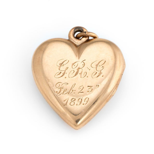 Elegant and finely detailed antique Victorian heart locket (circa 1899), crafted in 14k rose gold. The romantic heart was...