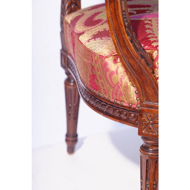 19th c. French finely carved Walnut Armchair, newly upholstered in silk