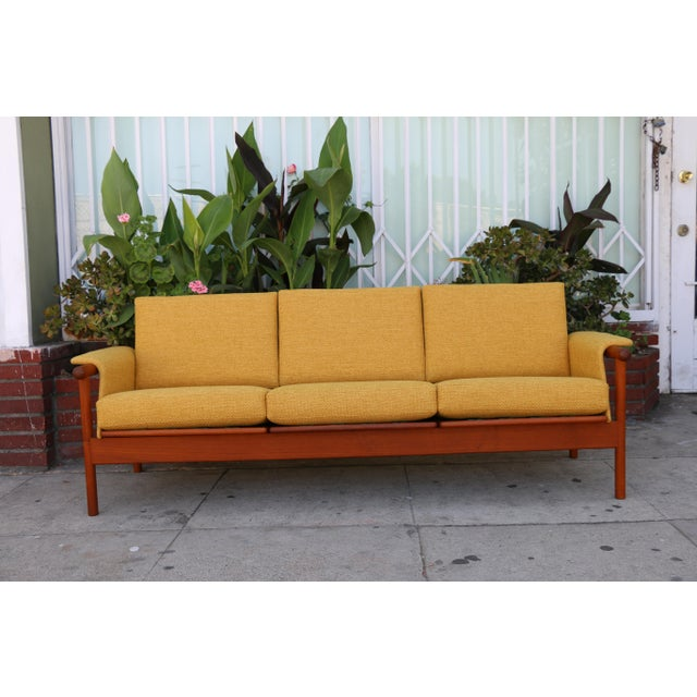 Just reupholstered mid century sofa. Walnut base is well taken care of and very sturdy. No rips or damages