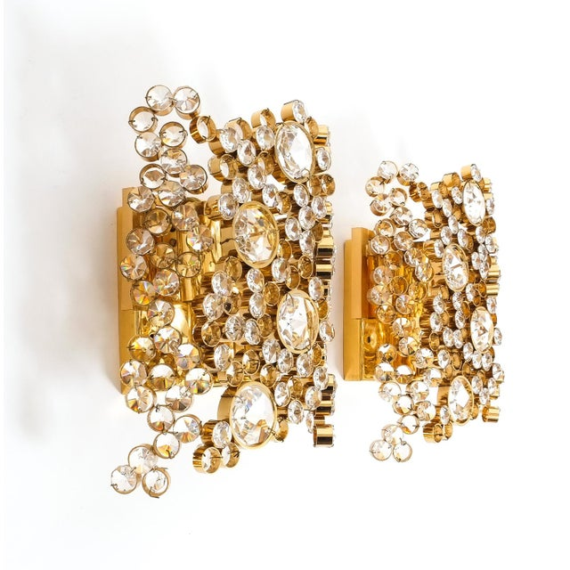 Beautiful pair of handcrafted sconces by Palwa, circa 1960 featuring hundreds of gilt brass rings encrusted with crystal...