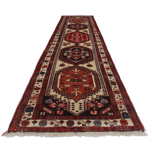 Crafted of hand-knotted wool, this Persian Ardebil runner features an all-over geometric design.