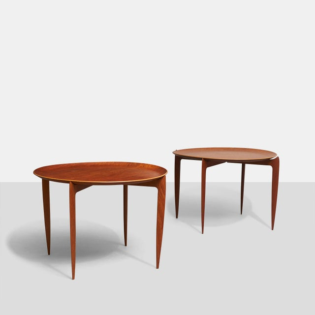 A pair of Fritz Hansen tray tables designed by Svend Aage-Williamson & H. Engholm with removable teak trays on tapered...