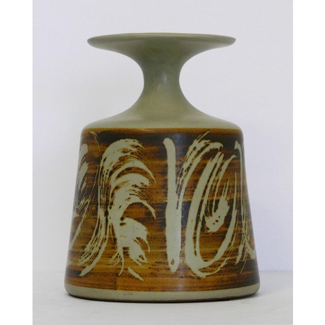 Designs West, CA stoneware vessel It has brown and beige abstracts over a gray glaze. There is a label / sticker on the...