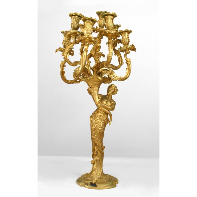 Pair of French Louis XV style (19th century) gilt bronze Bacchus and Bacchante figures holding nine-arm candelabra.