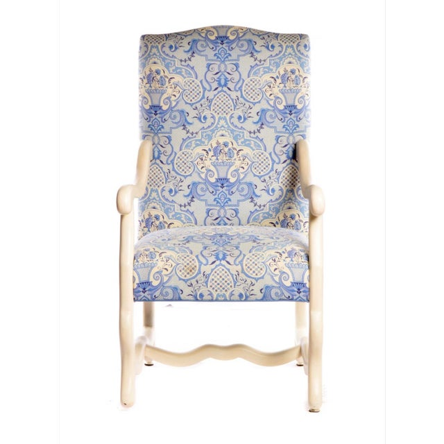This pair of Louis XIII style arm chairs feature a beautiful blue and antique white upholstery, painted frames and a...