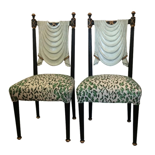 Fabulous pair of older black lacquer & parcel gilt drape-back side chairs in the Hollywood Regency style. The trompe-l'œil...
