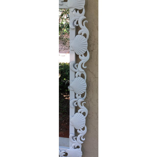 Fantastic pair of mirror made of iron. Artistically decorated with seashells and sea star motifs, painted in white lacquer...