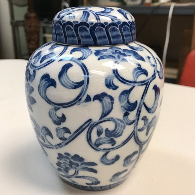 Gorgeous porcelain jar from Andrea by Sadek. Beautiful blue floral design. This beautiful piece would be a lovely addition...