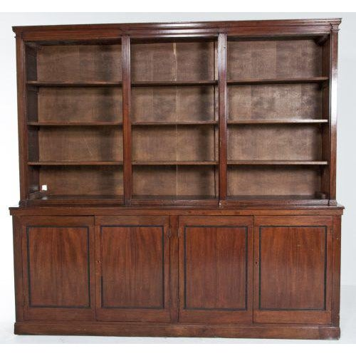 A late 19th century English mahogany bookcase, originally a storefront fixture to display and sell objects. The shelves,...