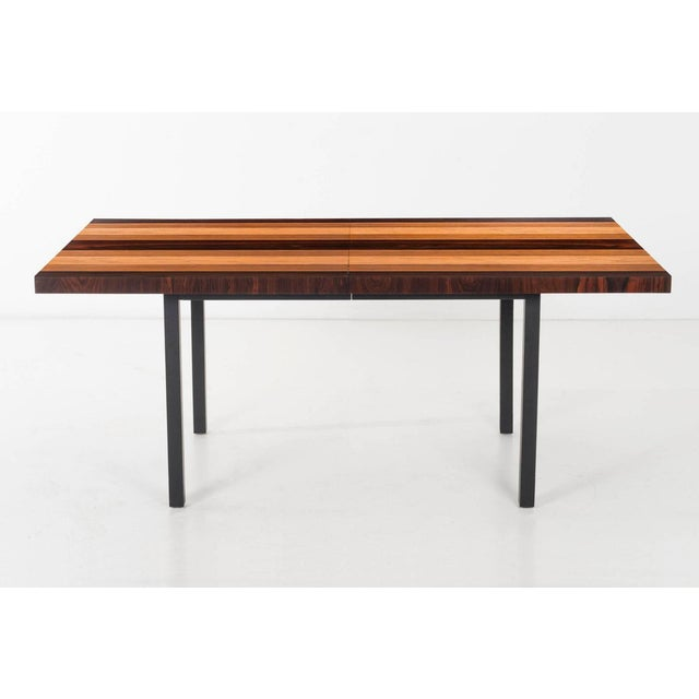 "Striped multi-veneer table, including rosewood, walnut, and ash. Two leave dining table that extends from 72"" - 108""."