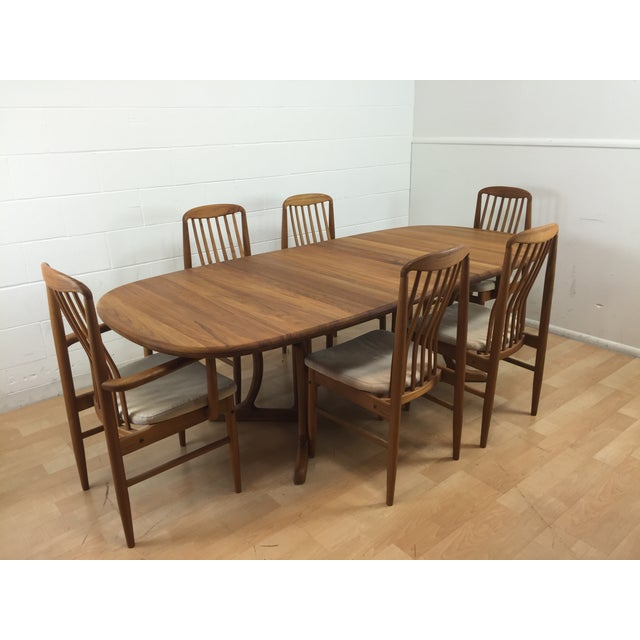 Benny Linden Design Dining Table and 6 Chairs. Mid-century Dutch modern dining set made of teak wood. Table and chairs are...