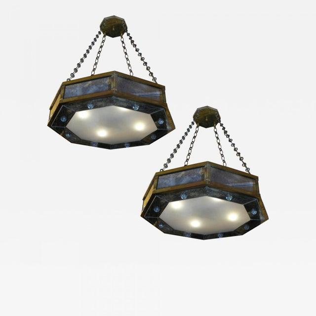 André Hayat pair of octagone chandelier in bronze and eglomisé mirror.