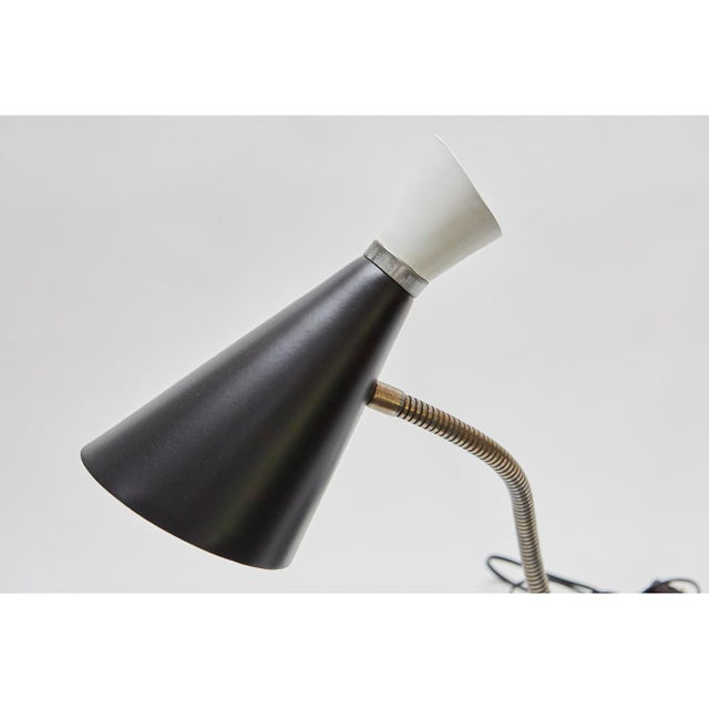This good looking black and white gooseneck double light lamp has the sophistication and whimsy of the period and will...