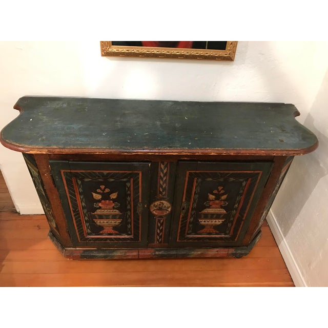 Circa 1780 American wooden fully free Handpainted Cupboard, two doors, and a shelf inside. Strong green background, richly...