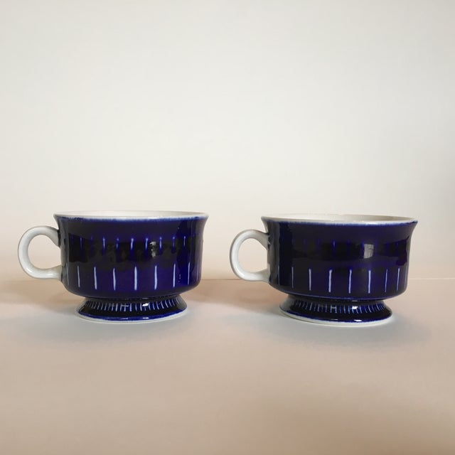 Offered is a pair of small vintage blue coffee/tea cups in Valencia by Arabia of Finland. Hand painted and signed by Ulla...