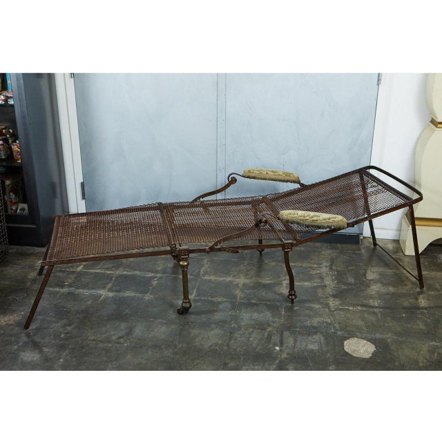 This unique piece of campaign furniture has an iron frame and woven metal body. It can be adjusted several ways to be used...