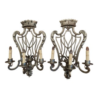 Pair of 19th Century French Louis XV Polished Iron Three-Light Sconces For Sale