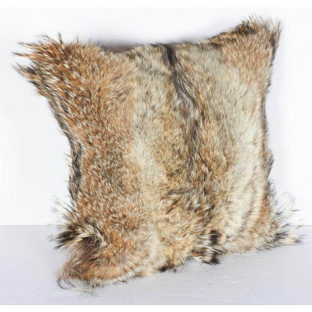 Bespoke ultra luxury decorative pillows. Handcrafted from genuine coyote fur in hues of, tan, camel, ivory and brown, with...