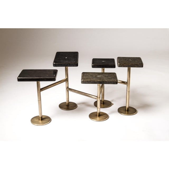 The 5-top rotating coffee table in antique black shagreen, jet black shagreen and black pen shell is completely mobile,...