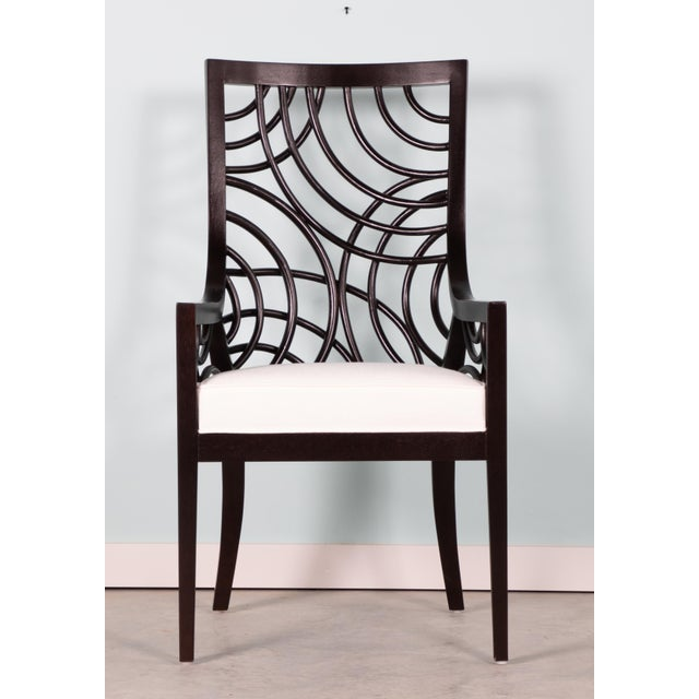 This set of David Francis Manhattan Dining Chairs feature a Mahogany frame with swirl rattan accents and an upholstered...