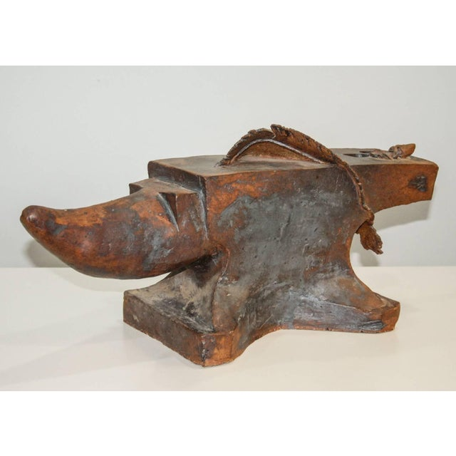 A large and stunning surrealist stoneware sculpture of an anvil incorporating a feather and finger. A great conversation...