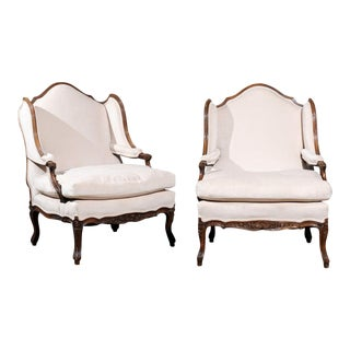 Pair of French Louis XV Style 19th Century Walnut Confessional Bergère Chairs For Sale