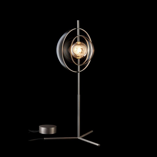 """The """"Captured"""" table lamp was designed by Michael Anastassiades for J. & L. Lobmeyr. """"Captured"""" lamps feature one bulb..."""