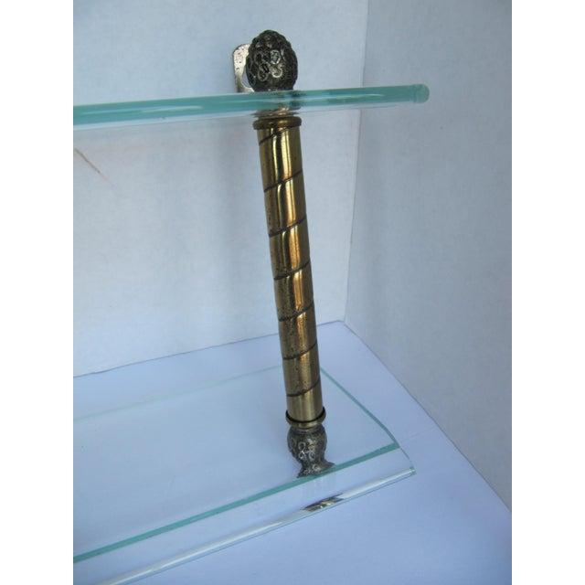Beautiful vintage glass and brass column design tiered shelf. Small chip on corner top shelf.