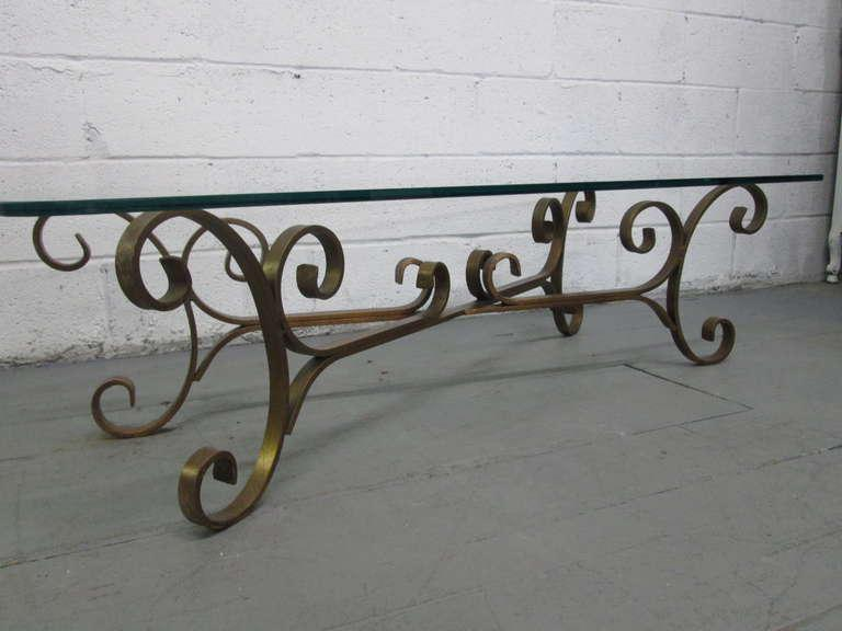 French Gilded Wrought Iron Coffee Table With A Decorative Base.