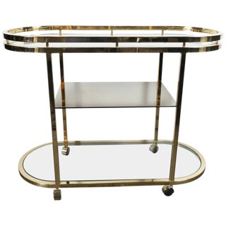 Mid-Century Modern Oval Polished Brass and Mirror Three-Tier Bar Cart on Casters For Sale