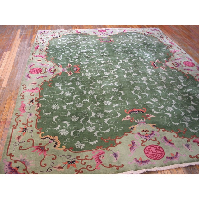 Antique Chinese Art Deco Rug with a green background and patterned border.