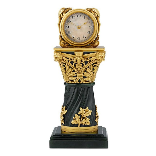 An exceptionally rare objet d'art, this opulent and incredibly rare French miniature clock is crafted of solid 18-karat...