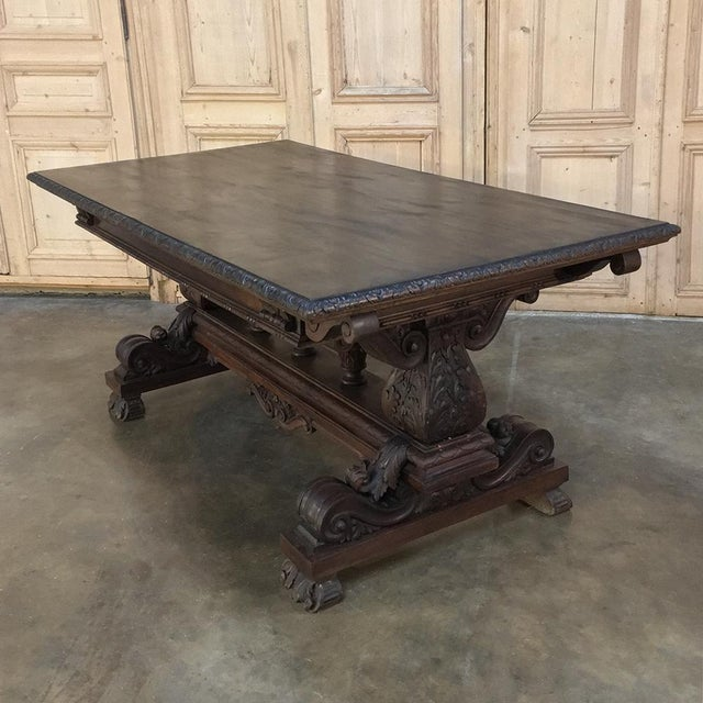 Antique Italian Renaissance Walnut Desk - Dining Table is a master work of the cabinetmaker's art, with boldly carved...