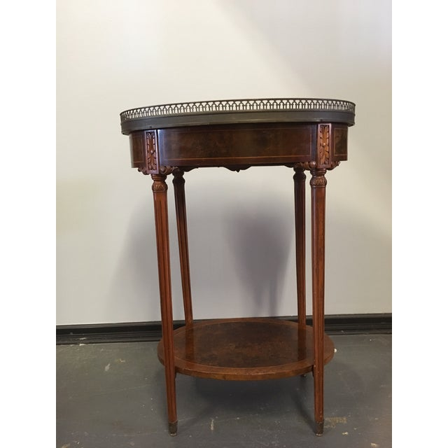 "Nicely scaled French circa 1900 ""Bouillotte"" side table with drawer, marble top, brass gallery rail and carved and burled..."