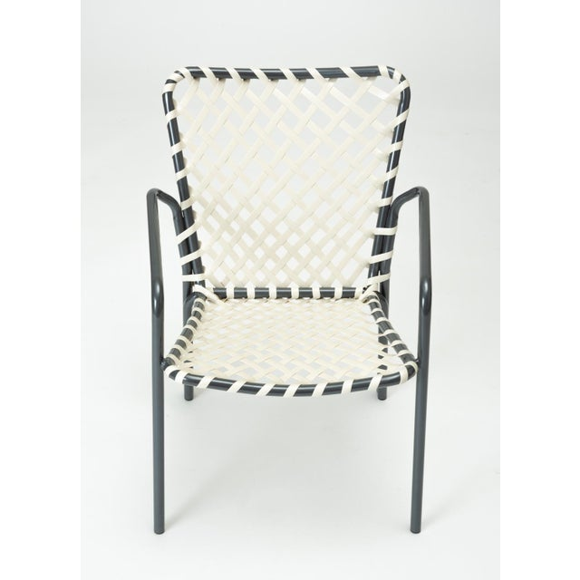 A set of eight patio dining chairs from the Ames Aire patio collection by the O. Ames Company of West Virginia. With a...