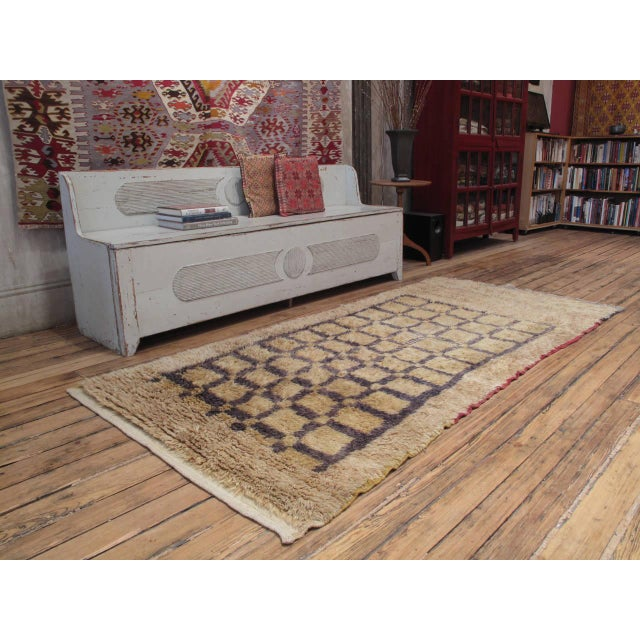 """The way the familiar grid pattern is rendered in this """"Tulu"""" style rug - covering only part of its surface, alternating..."""