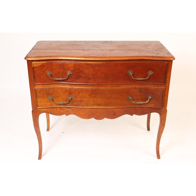 Louis XV provincial style beech wood, serpentine front, two drawer chest of drawers with steel pulls, circa 1900.