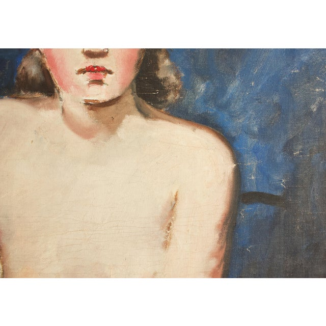 A truly striking wood framed painting of a partially nude woman. The subject's alabaster skin and rosy cheeks contrast...