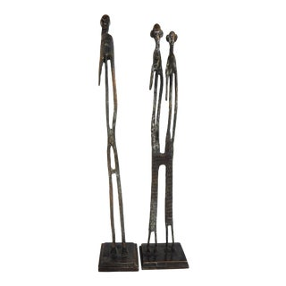 Giacometti-Style Bronze Figurative Sculptures - a Pair For Sale