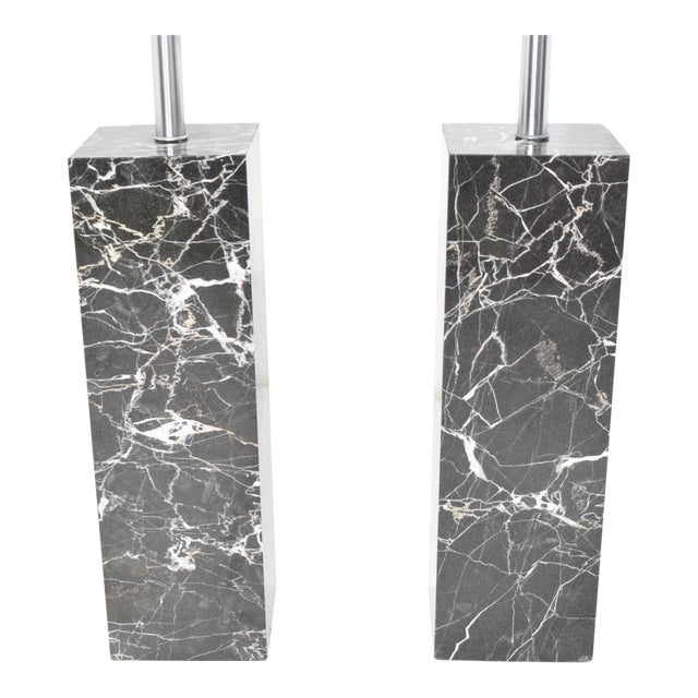 Beautiful pair of 1960s black and white veined marble block table lamps by Nessen Studio. These lamps are very heavy.