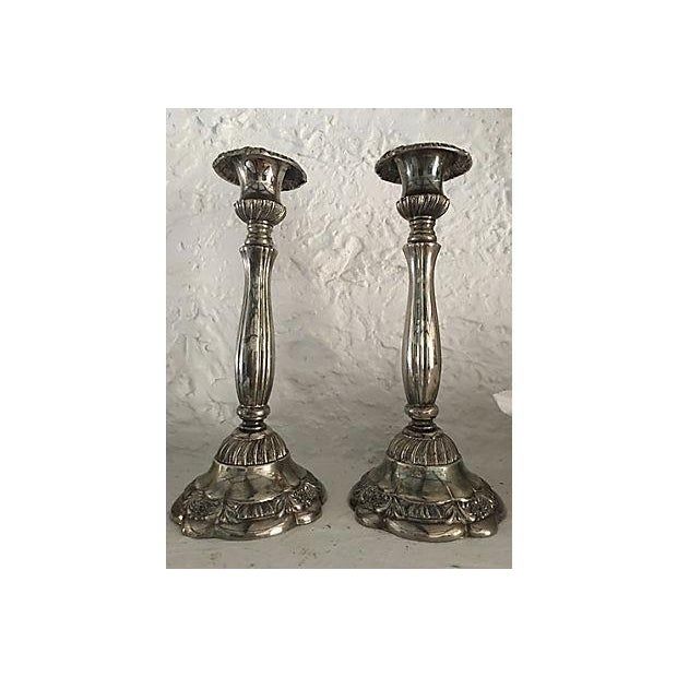 Gorgeous pair of silver-plate ornate tall candleholders. Marked Godinger on underside.
