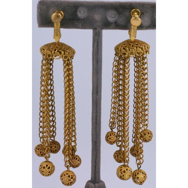 Attractive Miriam Haskell Russian gold plated chain and long filigree ball earrings. Striking length. Adjustable clip...