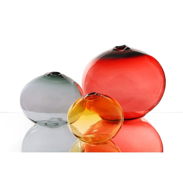 The SkLO float vessels are organic spheres of Czech glass with broken flame polished mouths. They are entirely free‑blown,...